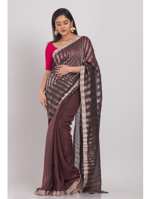 Brown linen saree with silver zari pallu...