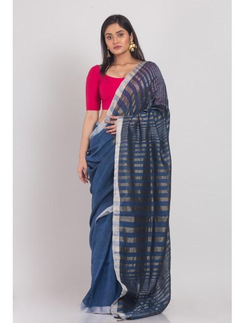 Blue linen saree with silver zari pallu ...