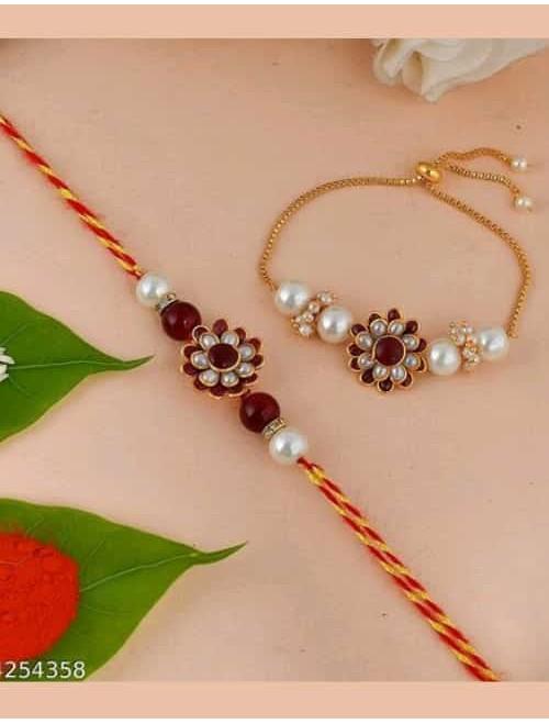 Beautiful Kundan and beads maroon rakhi ...